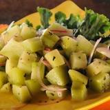 Chayote is a light green pear shaped and sized squash that is quite common in Puerto Rico, the Caribbean, as well as, throughout various countries of Latin America. The chayote is lightly poached then tossed with onions, olives, herbs, spices, and a light